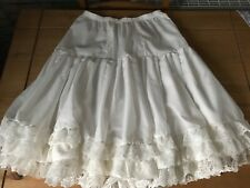 Ivory cotton  petticoat edged with three rows of lace
