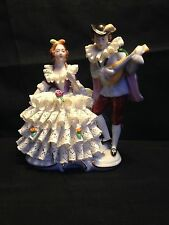 antique German porcelain.  Couple playing music. Marked GDR