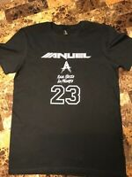 Black short sleeve T shirt with Anuel Real Hasta la Muerte design in white.