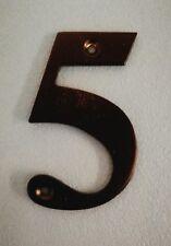 Black metal door number 5
