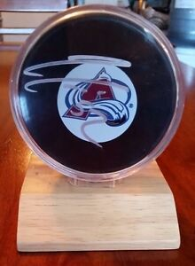 Signed Adam Foote #23 Avalanche hockey puck
