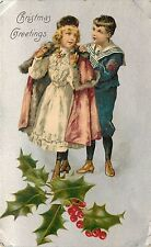 Unposted 1901-17 Winsch Printed Postcard Christmas Sailor Boy helps Girl w Coat