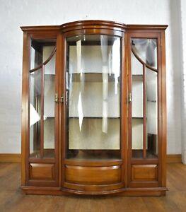 Antique triple door glazed bowfront display cabinet