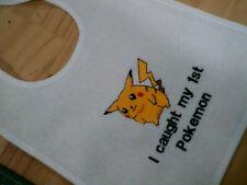 funny captions  baby bib.....i caught my first pokemon