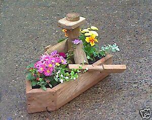 hand made designer rustic garden planter man in boat