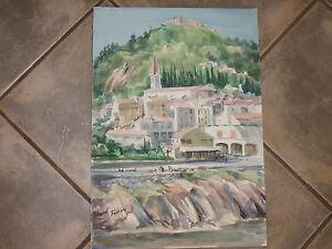 Un village, Aquarelle signée Guy Fantou, époque 20ème.