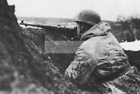 WWII photo German paratrooper in a trench on the Eastern Front 1270