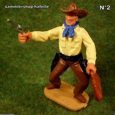 Timpo Toys Made in GT.Britain Cowboy mit Revolver schießend & US.Geldtasche