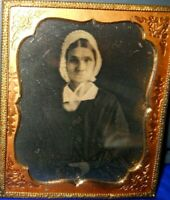 1/6th Size Daguerreotype of Lady in Brass frame/mat