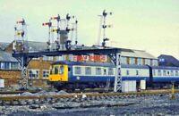 PHOTO  DMU UNIT B491 PASSES SEMAPHORE SIGNAL GANTRY. TAUNTON. C1980S