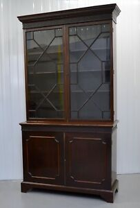 A CHIPPENDALE REVIVAL MAHOGANY BOOKCASE, MOULDED OUTSWEPT CORNICE ABOVE/ C 1870