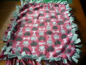 Handmade fleece tie blanket of hearts and paws on pink for a small pet