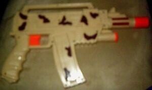 Battery operated kalishnikov AK-47 toy machine gun barrel goes backforth Works