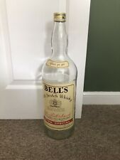 More details for vintage empty 4.5l bells whisky bottle with cap embossed glass man cave coins