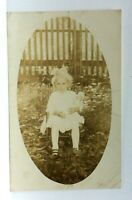RPPC Little Girl Sitting In Chair With Doll Vintage Postcard