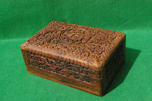 A HIGHLY DECORATED CARVED HINGED WOOD BOX  IN HARDWOOD TYPE H