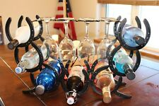 horseshoe wine rack holds 7 bottles and four glasses