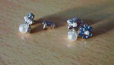 Zilverkleurige oorbellen met witte parels en blauwe strass bloem  NIEUW