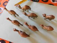 set of 8 small metal Camels brass