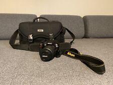 Nikon D D3000 10.2MP Digital SLR Camera - Black (Camera Kit)