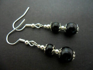 A PAIR OF PRETTY BLACK GLASS PEARL AND SILVER  PLATED DANGLY EARRINGS. NEW.