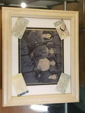 Mint Foo Fighters 1996 picture signed by all 4 members with certification.