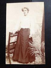 M10 postcard Edwardian Undated Lady Chair Flowers Long Dress K465