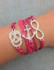 Bracelet strass rose fushia tête de mort  strass ancre et lien infini strass