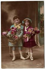 TWO LITTLE CHILDREN - Colette #311 - Flowers - c1910s era Real Photo postcard
