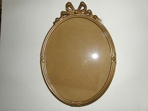 OVAL PHOTO FRAME WITH BOW TIE.