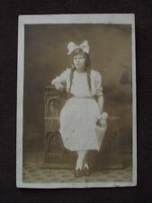 TEN YEAR OLD GIRL WITH LARGE BOW IN HER HAIR  VTG  REAL PHOTO POSTCARD