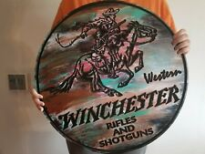 Vintage looking Winchester sign arms and ammunition.