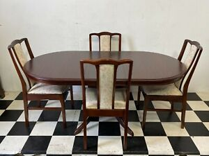 Stag Minstrel oval extending dining table with four matching chairs - Delivery