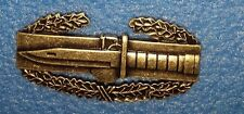 US ARMY BADGE , METAL, COMBAT ACTION BADGE, OXIDIZED