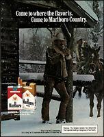 1979 Cowboys Marlboro cigarettes snowfall cabin vintage photo print ad ads80