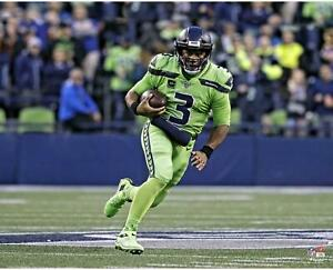 """Russell Wilson Seattle Seahawks Unsigned Color Rush Scramble 16"""" x 20"""" Photo"""