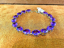 14k Yellow Gold Amethyst Tennis Bracelet 7 inches.