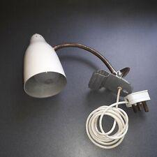 Vintage industrial adjustable clip on desk light.