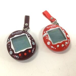 Two 2004 Tamagotchi Toys with Hanging Fixture #413