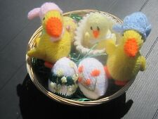 A HAND KNITTED EASTER DECORATIONS BASKET.