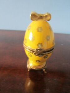 Egg shaped gold limoges perfume case with bottle