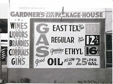POST CARD OF OLD PACKAGE GOODS STORE AND GAS STATION SIGN FROM 1930'S