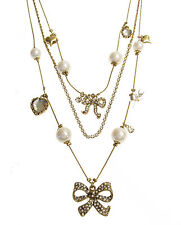 BETSEY JOHNSON Iconic Pave Bow Charm Beaded Gold-Tone Illusion Necklace