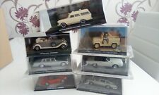 James Bond Car Collection- 7 cars all with damaged cases.