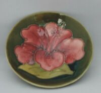 Moorcroft Hibiscus Dish on green ground - impressed and marks to base - 9.5cm...