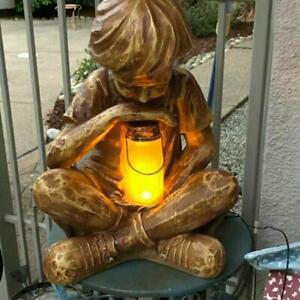 Carved Wood Look Little Boy w/ Solar Lighted Fireflies In Jar Garden Statue