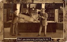 VTG 1911 ROMANTIC HUMOR POSTCARD Woman to Man Pay for Me Yard Cloth Store A53