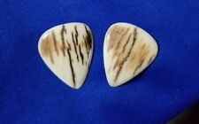 Hand crafted genuine fossil bark guitar pick