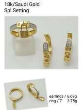 Gold Authentic 18k saudi gold ring size 7 and earrings,,