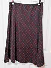 NONI B SIZE LARGE RED AND BLACK SHORT SKIRT
